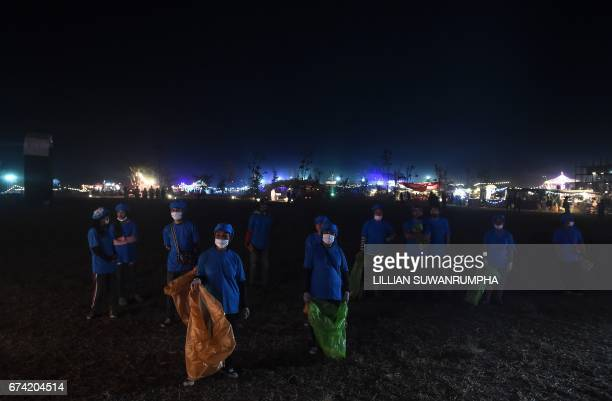 This picture taken on February 17 2017 shows cleaners from the northern Thai province of Isaan watching the AllThidsa molam band perform at the...