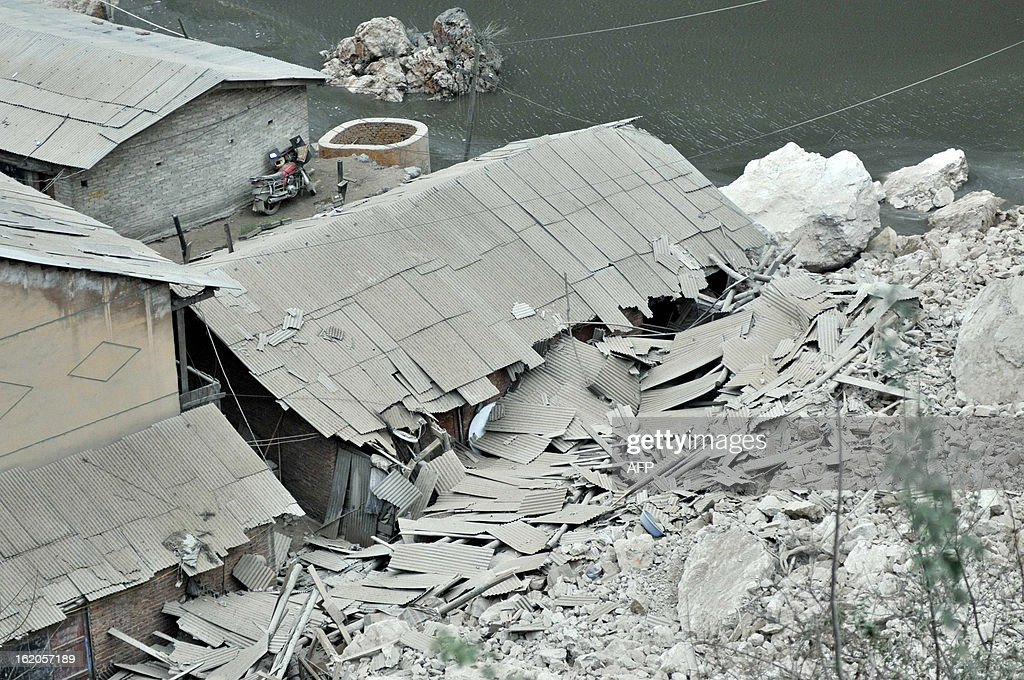 This picture taken on February 18, 2013 shows the damaged coal mine area after a landslide happened at around 11 am on February 18 in Longchang Township in the city of Kaili, southwest China's Guizhou province. Initial investigation has found that five people, including two children, were buried after the landslide. CHINA OUT AFP PHOTO