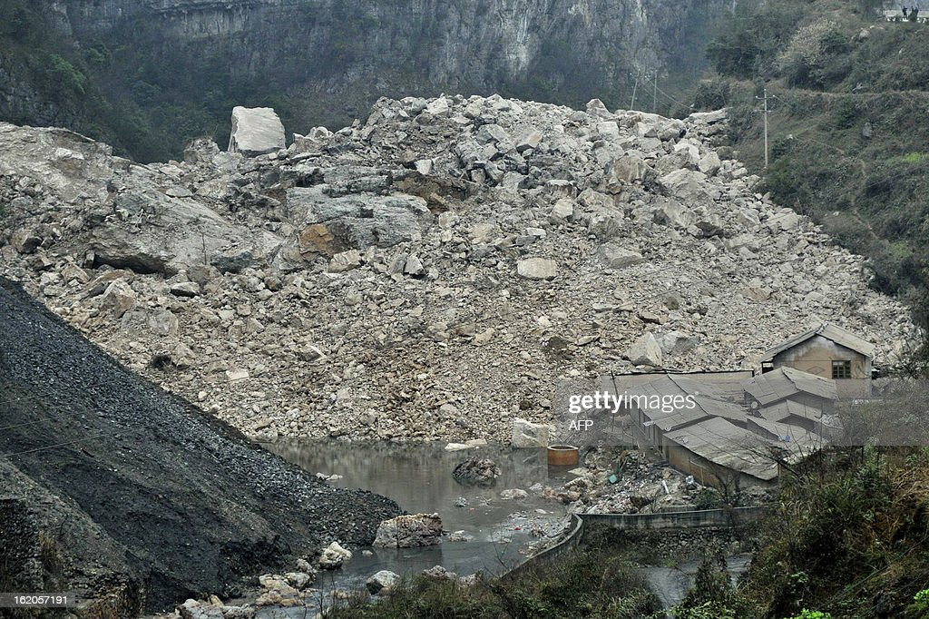 This picture taken on February 18, 2013 shows the damaged coal mine area after a landslide happened at around 11 am on February 18 in Longchang Township in the city of Kaili, southwest China's Guizhou province. Initial investigation has found that five people, including two children, were buried after the landslide. CHINA