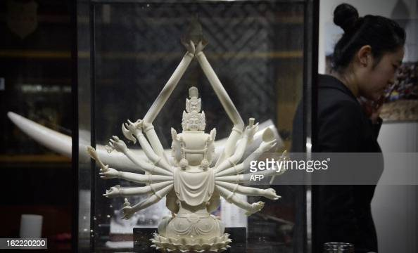 This picture taken on February 20 2013 shows an ivory Buddha carving on display at an ivory shop in Beijing The number of African elephants killed by...