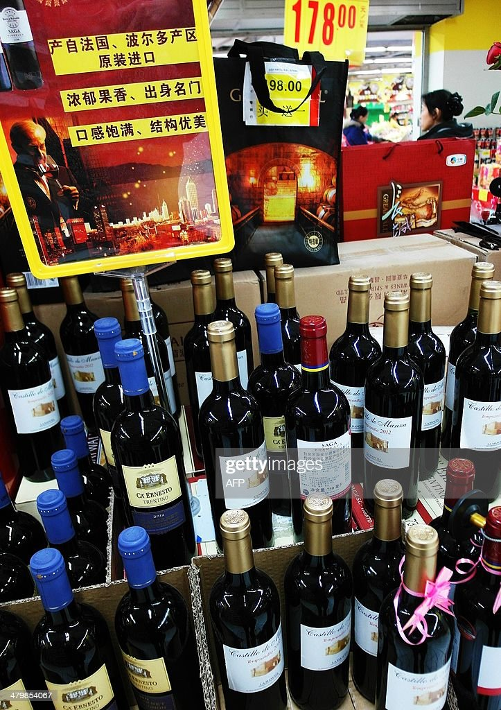 This picture taken on February 21, 2014 shows wine on sale in a supermarket in Yichang, central China's Hubei province. The Chinese and European wine industries have agreed a deal that will see Beijing end an anti-dumping inquiry into imports from the European Union, China's commerce ministry said on March 21. CHINA