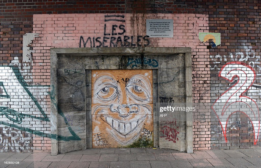 This picture taken on February 22, 2013 shows graffiti covering the entrance to the former East German shelter in Berlin.