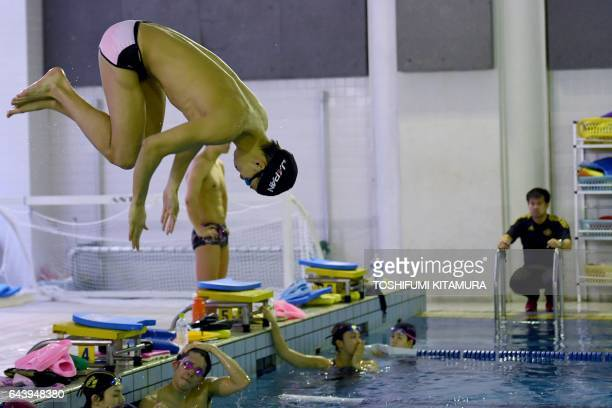 This picture taken on February 22 2017 shows Japanese swimmer Ippei Watanabe diving into the pool during a training session at the Waseda University...