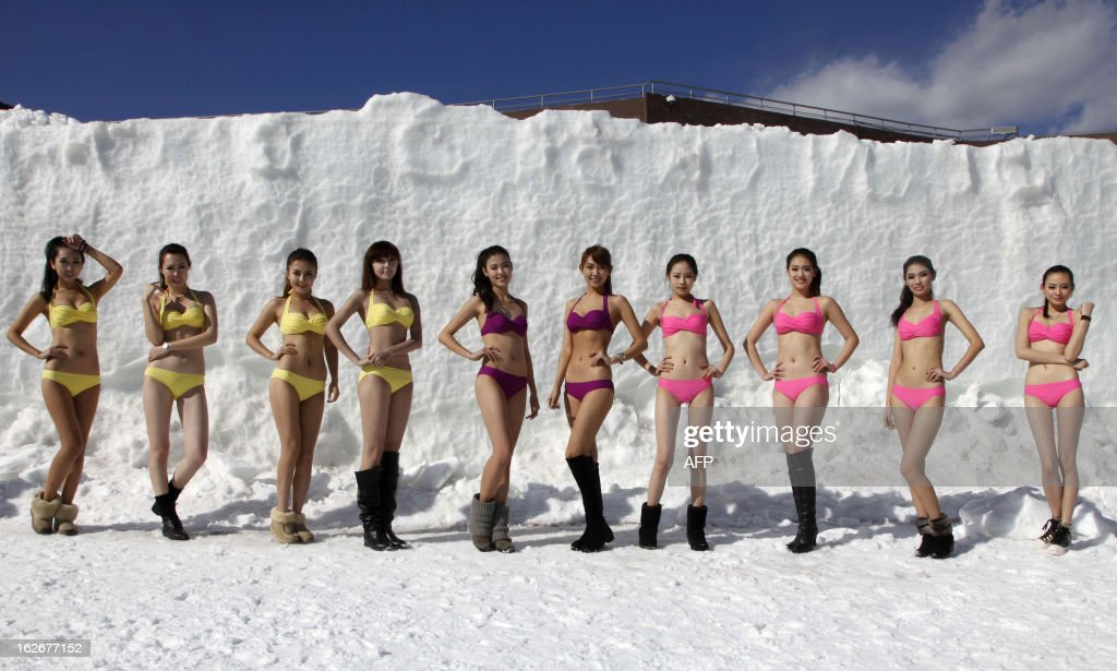 This picture taken on February 23, 2013 shows contestants posing in swimsuits during a beauty contest at a ski resort in Shenyang, northeast China's Liaoning province. 200 participants took part in the contest which lasted for two months. CHINA OUT AFP PHOTO