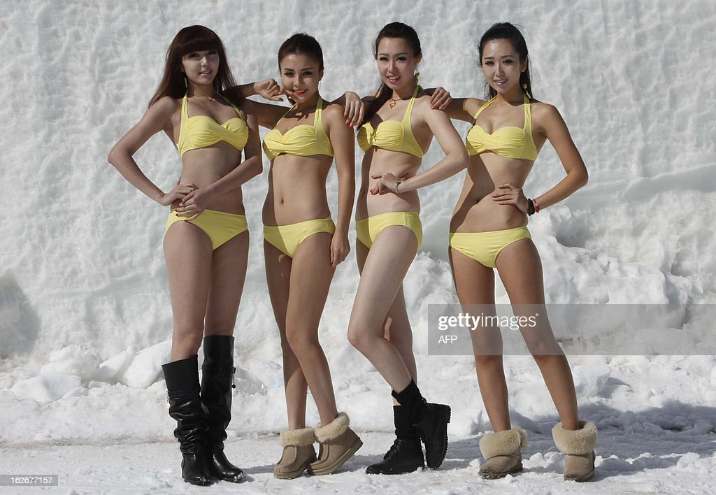 This picture taken on February 23, 2013 shows contestants posing in swimsuits during a beauty contest at a ski resort in Shenyang, northeast China's Liaoning province. 200 participants took part in the contest which lasted for two months. CHINA