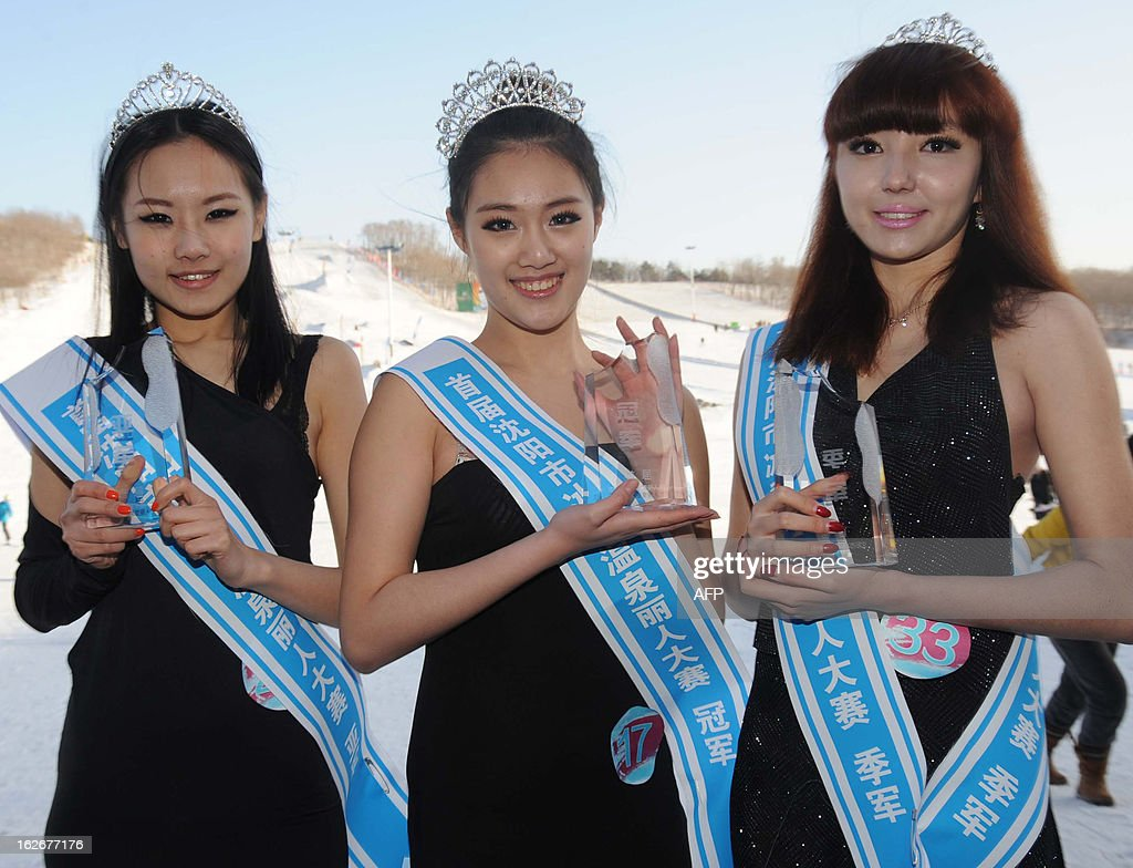This picture taken on February 23, 2013 shows contestants posing with their winner's trophies after a beauty contest in Shenyang, northeast China's Liaoning province. 200 participants took part in the contest which lasted for two months. CHINA