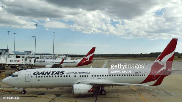 This picture taken on February 23 2015 shows a Qantas plane leaving a departure gate at Melbourne International Airport Australian carrier Qantas on...
