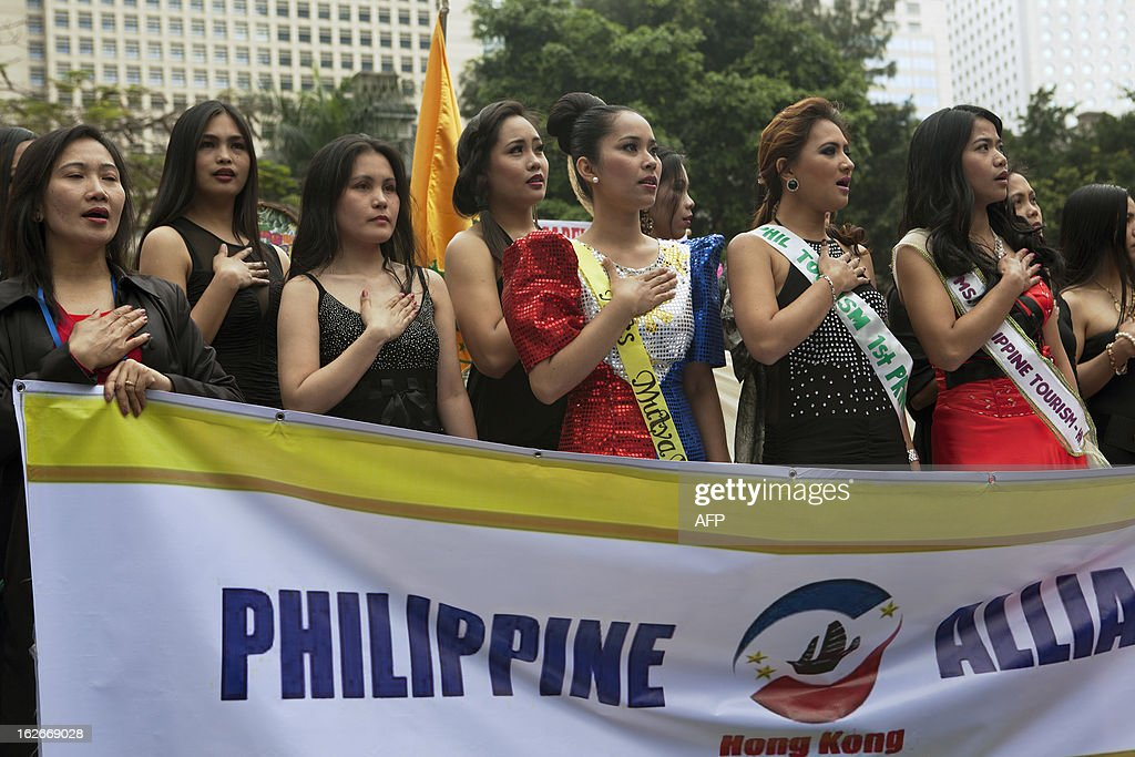 This picture taken on February 24, 2013 shows foreign workers singing the Philippine national anthem during a cultural event on their day off in Hong Kong. A three-day court hearing for a case which will affect whether thousands of domestic maids could be eligible for residency status in the city began on February 26, 2013 at the court of final appeal in Hong Kong. AFP PHOTO / Anthony WALLACE