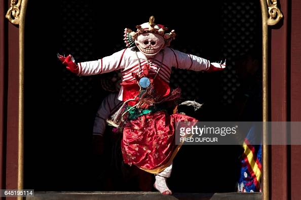 TOPSHOT This picture taken on February 24 2017 shows a Tibetan monk dressed as a demon performing a dance for the Beating Ghost festival during a...
