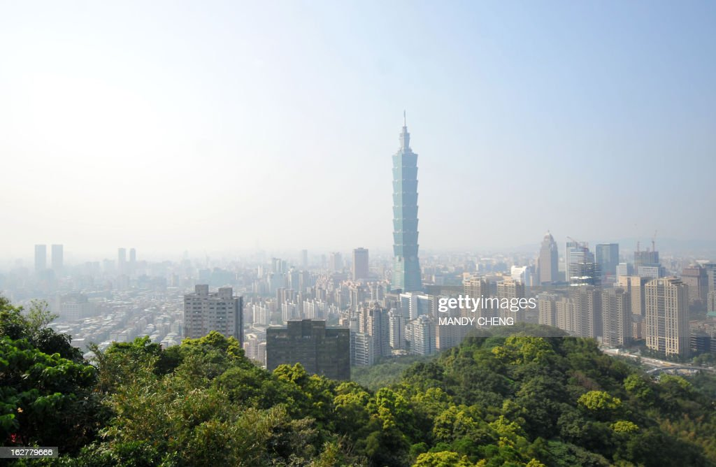 This picture taken on February 25 2013 shows a haze of pollution sitting over the city's skyline in Taipei AFP PHOTO / Mandy CHENG