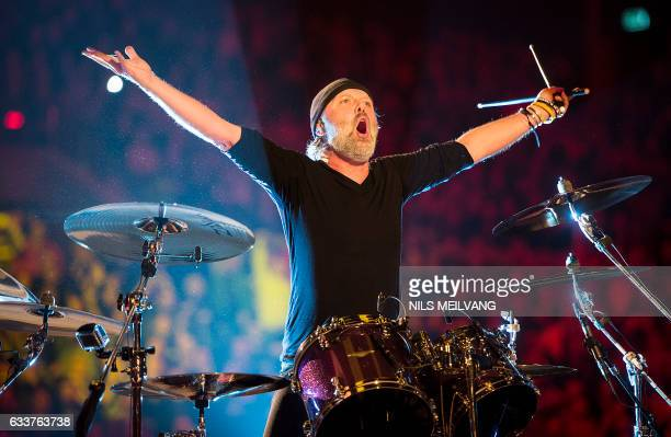 This picture taken on February 3 2017 shows Danish drummer Lars Ulrich of Metallica as he reacts during the opening of the new Royal Arena in...
