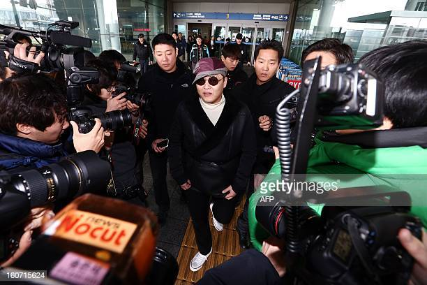 This picture taken on February 4 2013 shows South Korean rapper Psy arriving at the Incheon International Airport to take a onedayrest after planes...