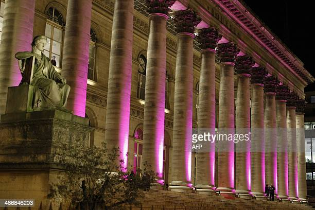 This picture taken on February 4 shows the Palais Brongniart in Paris by night as it is illuminated for a private event AFP PHOTO / LUDOVIC