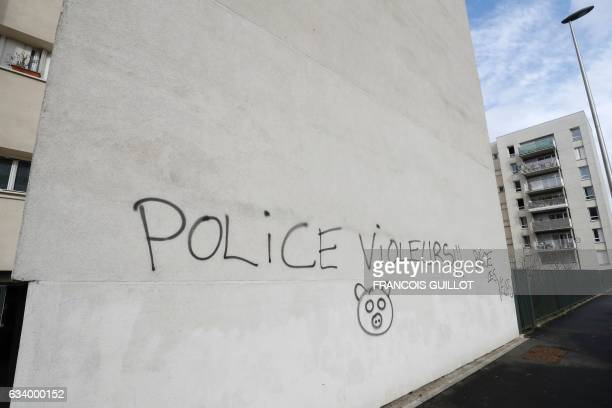 This picture taken on February 6 shows a tag reading 'police rapists' in AulnaysousBois Clashes between young protesters and police forces sparked...