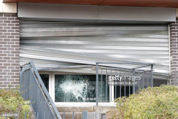 This picture taken on February 6 shows a window of the local police station smashed overnight by protesters in AulnaysousBois Clashes between young...