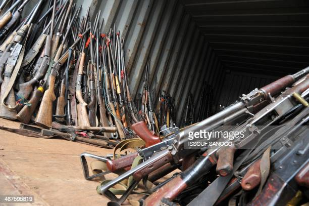 This picture taken on February 7 at the Mpoko camp in Bangui shows weapons gathered by French soldiers of the Sangaris military operation and seized...