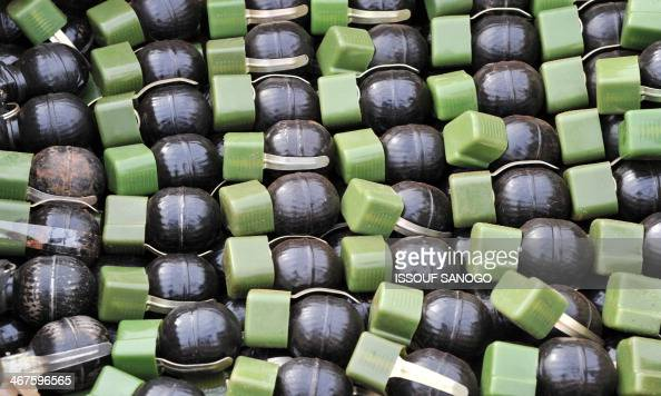 This picture taken on February 7 at the Mpoko camp in Bangui shows grenades gathered by French soldiers of the Sangaris military operation and seized...