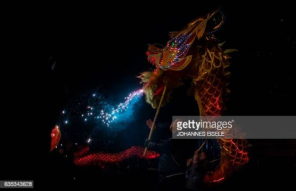 TOPSHOT This picture taken on February 9 2017 shows villagers parading a dragon through Peitian village Liancheng county of China's eastern Fujian...