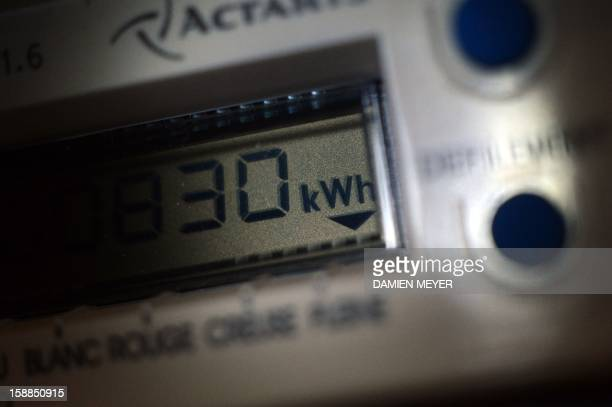 This picture taken on January 01 2013 shows an electricity meter in a house in the western city of Rennes AFP PHOTO / DAMIEN MEYER