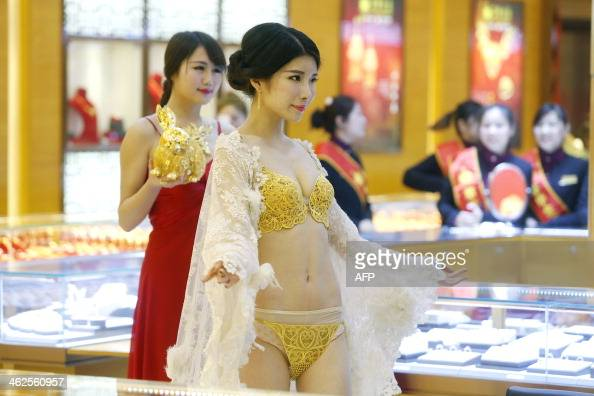 This picture taken on January 11 2014 shows a model displaying a set of underwear made of gold in a gold shop in Wuhan central China's Hubei province...