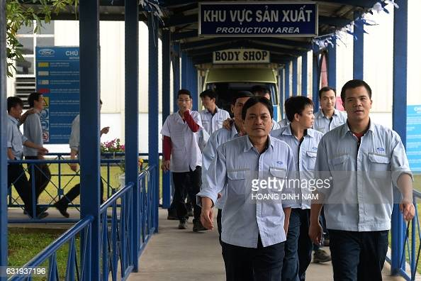This picture taken on January 11 2017 shows Vietnamese employees leaving for their lunch break at the Ford automotive plant in the northern province...