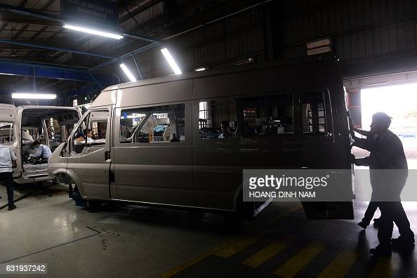This picture taken on January 11 2017 shows Vietnamese employees on the assembly line at the Ford automotive plant in the northern province of Hai...