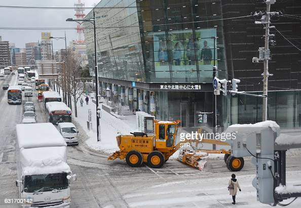 This picture taken on January 14 2016 shows a snowplow getting out on a main road in Niigata The Japan Meteorological Agency issued warnings against...