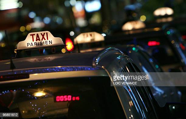 This picture taken on January 15 2010 shows taxi cars in Paris AFP PHOTO LOIC VENANCE