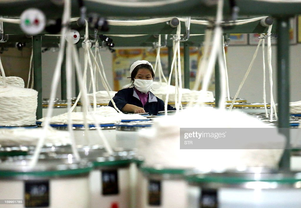 This picture taken on January 16, 2013 shows a woman working in a textile factory in Jiujiang, east China's Jiangxi province. China's manufacturing activity expanded in January at its fastest pace in two years, HSBC said on January 24, the latest sign of recovery in the world's second biggest economy. CHINA