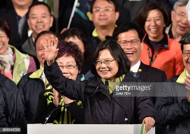 This picture taken on January 16 2016 shows Tsai Ingwen the presidentelect of the Democratic Progressive Party waving after her victory in the...