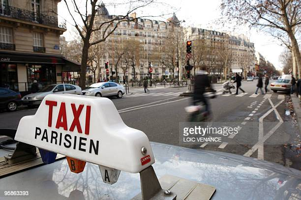 This picture taken on January 17 2010 shows a taxi sign on a car in Paris AFP PHOTO LOIC VENANCE