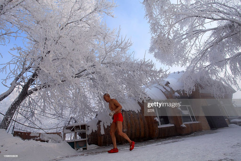 This picture taken on January 17, 2013 shows 77-year-old retired teacher Gao Yinyu running in his underwear at a snow-covered bathing spot in Jilin, in northeastern China's Jilin province, in a temperature of minus 25 degrees Celsius. Gao has been exercising in only his underwear every morning for more than the past decade and has rarely caught cold ever since retirement. CHINA