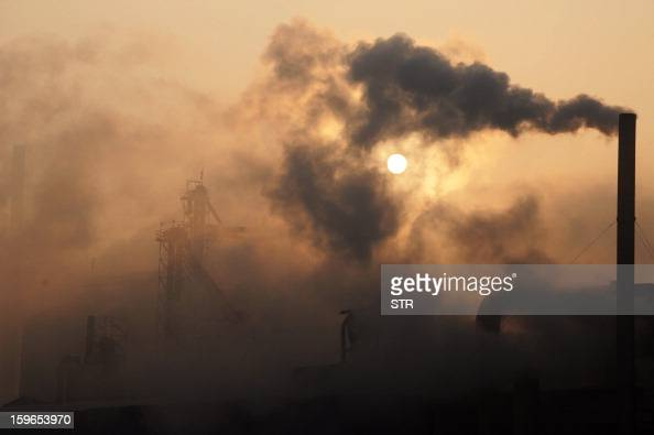 This picture taken on January 17 2013 shows a cement factory releasing heavy smoke in Binzhou in eastern China's Shandong province China's economy...