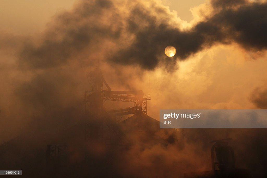 This picture taken on January 17, 2013 shows a cement factory releasing heavy smoke in Binzhou, in eastern China's Shandong province. China's economy grew at its slowest pace in 13 years in 2012, the government said on January 18, but an uptick in the final quarter pointed to better news ahead for a prime driver of the tepid global recovery. CHINA