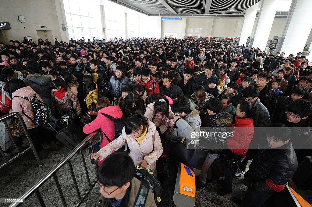 This picture taken on January 17, 2013 shows people headed to their trains after waiting at a railway station in Hefei, in central China's Anhui province. China's working-age population declined for the first time in recent decades in 2012, the government said on January 18, as it detailed the extent of the demographic time bomb the country faces. CHINA OUT AFP PHOTO