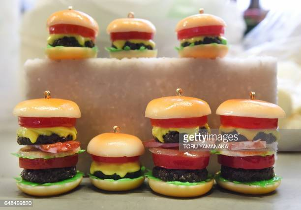 This picture taken on January 18 2017 shows plastic hamburger earrings made at the studio of Fake Food Hatanaka in Tokorozawa a suburb of Tokyo In...