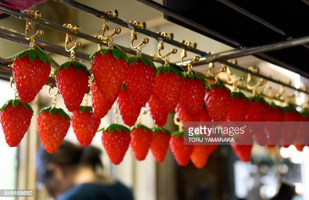 This picture taken on January 18 2017 shows plastic strawberry earrings made at the studio of Fake Food Hatanaka in Tokorozawa a suburb of Tokyo In...