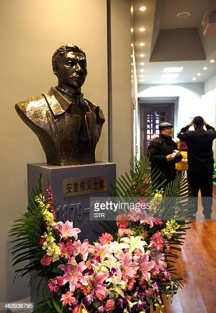 This picture taken on January 19 2014 shows Chinese visitors looking at exhibits at a memorial in Harbin northeastern China's Heilongjiang province...
