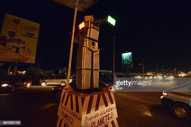 This picture taken on January 21 2014 shows a traffic robot cop on Triomphal boulevard of Kinshasa at the crossing of Asosa Huileries and Patrice...