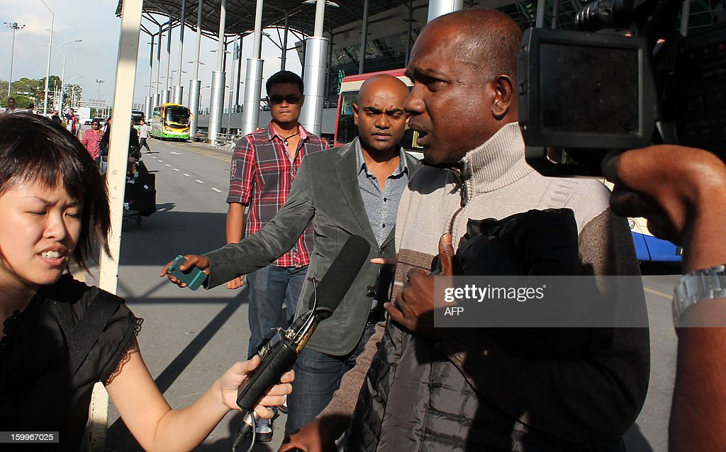 This picture taken on January 23, 2013 shows one of a Malaysian survivor of Algeria hostage crisis Ravi Kappusamy (R) talking to the media at Penang airport upon his arrival from East Algeria. The hostage crisis that took place last week, a militant group held 130 Amenas OGPC staff from various countries, including five Malaysians. According to a report the Malaysian embassy in Algiers confirmed that Malaysian Chong Chung Ngen, who was reported missing, has been killed in the incident.