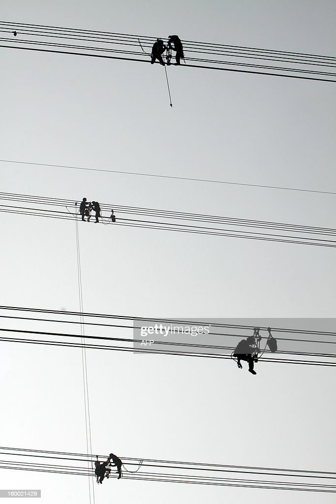 This picture taken on January 24, 2013 shows laborers working on wire in Jiashan, east China's Zhejiang province. China's manufacturing activity expanded in January at its fastest pace in two years, HSBC said on January 24, the latest sign of recovery in the world's second biggest economy. CHINA