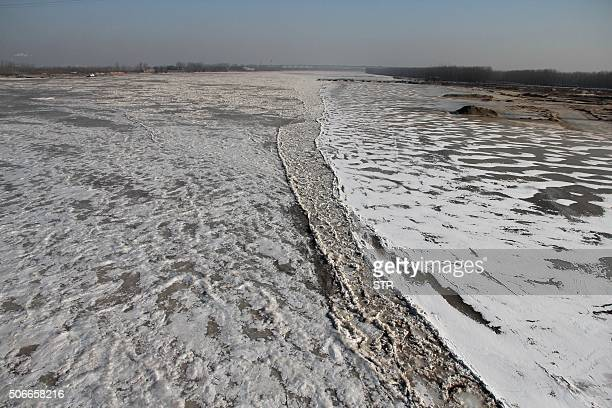 This picture taken on January 24 2016 shows the Yellow River frozen due to the recent cold weather in Binzhou in eastern China's Shandong province...