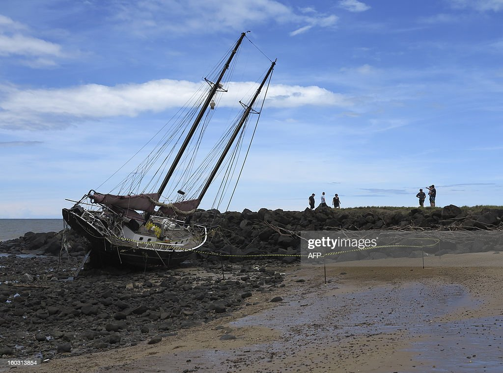This picture taken on January 28, 2013 shows the twin masted yacht the 'Patricia Mary' washed up on Baraga Beach in Bundaberg after the passing of tropical cyclone Oswald. Australia ramped up its military response to deadly floodwaters rising in the country's sodden northeast on January 29 which have killed four people and displaced or isolated tens of thousands. Storms triggered by ex-tropical cyclone Oswald have claimed four lives -- the most recent a three-year-old boy killed by a falling tree -- as heavy rains have brought flooding to the states of Queensland and New South Wales. AFP PHOTO / Cameron ROBINSON