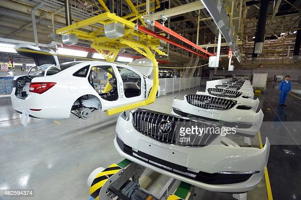 This picture taken on January 28 2015 shows the US auto giant General Motors Buick cars being assembled at Wuhan auto plant in Wuhan central China's...