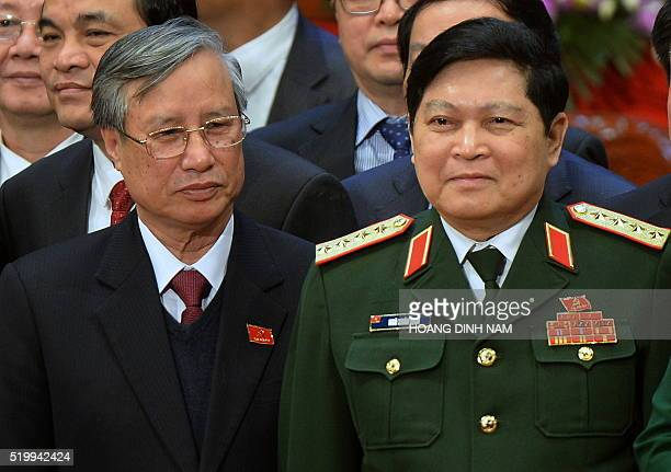 This picture taken on January 28 2016 shows newly elected politburo member Gen Ngo Xuan Lich posing with others members of the Vietnam Communist...