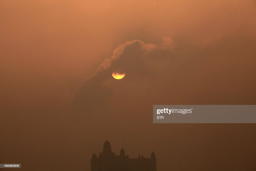 This picture taken on January 29, 2013 shows the sun partly obscured by cloud in the heavy smog in Jilin, northeast China's Jilin province. Across China public frustration mounted this week as dense smog blanketed swathes of the country, with even state-run media questioning the authorities' ability to meet their goal of building a 'beautiful China'. CHINA OUT AFP PHOTO