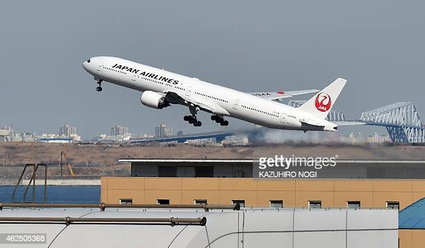 This picture taken on January 29 2015 shows a Japan Airlines passenger plane taking off from Tokyo's Haneda airport Japan Airlines said on January 30...