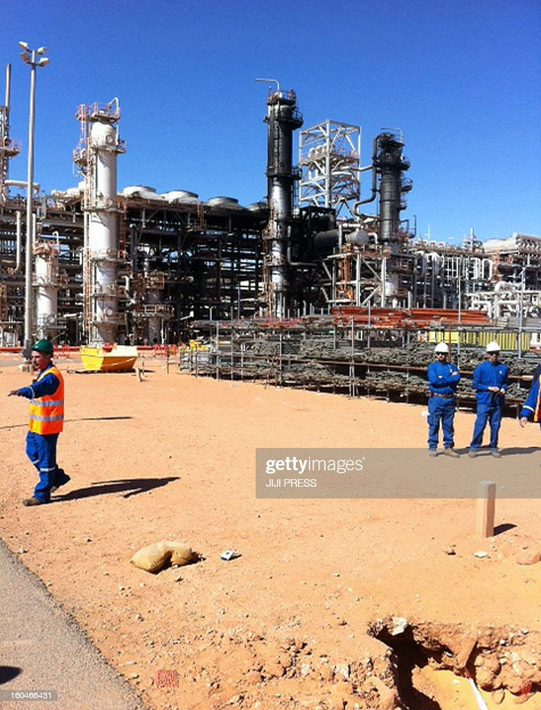 This picture taken on January 31, 2013 shows workers outside the JGC In Amenas gas plant in the Sahara desert after it opened to the press the first time after dozens of foreigners were killed during a four-day standoff that ended in a bloody showdown with Algerian commandos in In Amenas. Algeria has said 38 workers, out of which 37 were foreign, and 29 kidnappers died in the hostage taking. AFP PHOTO / JIJI PRESS JAPAN OUT