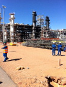This picture taken on January 31 2013 shows workers outside the JGC In Amenas gas plant in the Sahara desert after it opened to the press the first...