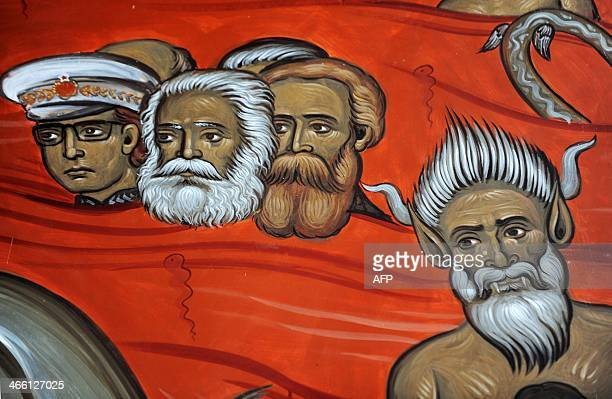 This picture taken on January 31 shows a fresco with the portraits of late German philosophers Karl Marx and Friedrich Engels alongside Yugoslav...